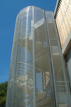 Transparent emergency staircase cladding made with architectural wire mesh.