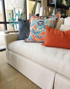 In love with these new pillows! #dragon #navyandorange #chinoiserie #skirtedsofa #westenddevine #shoplocal #shopcolumbia #orangeandturquoise #westendinteriors