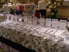 "Great way to display similar items in one section - ""Date Night set up at the Delta Rotary 2011 Auction"""