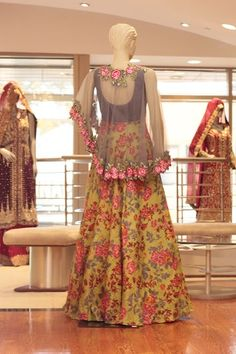 Green and Grey Floral Poncho style Fabric: Raw Silk and Net For more information please contact sales@sahil.com and visit us at www.sahil.com