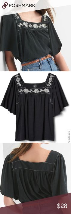 Gap 100% cotton tee with embroidered flowers. Sold out in xxl at Gap. Loose flowing top by Gap. 100% cotton in a black with white flower embroidered design. Loose sleeves and flows bottom. This is not a long tunic it hits top hip. It's also not a dark black. I have 2 in XXL worn once. GAP Tops Tees - Short Sleeve