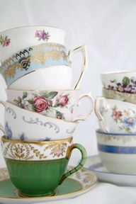 stacked vintage cups ... use them as place card display with names attached to each cup?