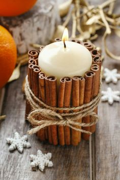 Cinnamon stick candle holder DIY project: Use hot glue to make the cinnamon stick . Cinnamon stick candle holder DIY project: Use hot glue to attach the cinnamon sticks and wrap in gardening yarn. This is one of the ideas for great au. Christmas Candle Decorations, Christmas Candles, Christmas Diy, Fall Decorations, Natural Christmas, Scandinavian Christmas, Diy Candle Holders Christmas, Crafts To Make And Sell Unique, Christmas Crafts To Make And Sell