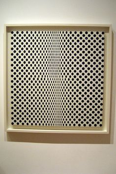 Bridget Riley.. Pretty sure Roger Sterling has this hanging in his office on Mad Men
