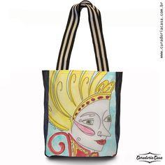 Rainha, bolsa tote da coleção Fantasias, produzida a partir das aquarelas de Aline Pascholati. O objetivo da artista é mostrar o lado mágico da vida, a partir de personagens enigmáticos e imagens bem coloridas.
