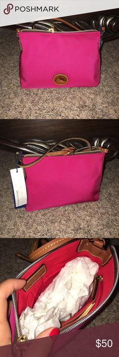 New authentic Dooney & Bourke crossbody pouchett! Comes from a smoke free home! Brand new with tags! Mixture of a pink and red together but mostly a pink color! Dooney & Bourke Bags Crossbody Bags
