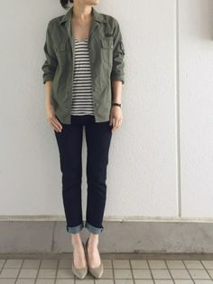 Striped top, olive military shirt or utility jacket, dark skinny jeans with pointed toe ballet flats.