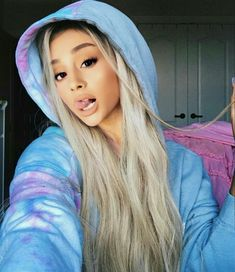 Ariana Grande taking a selfie with light blonde long hair.:).