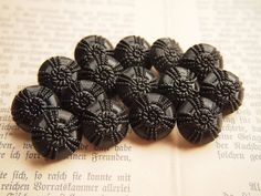 Vintage Glass Buttons , lot of 18 Glass Buttons/ Black flowers. $13.00, via Etsy.