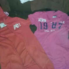 Aeropostale bundle! 4 total items! 1 orange zip-up hoodie 1 pink colored tee,  1 brown pullover hoodie & 1 white tank!  Both the orange hoodie and the pinky are in great condition the brown hoodie has a spot on the front and price reflects this. Aeropostale Tops