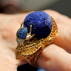 An industrious dung beetle pushes a deep-blue ball of the rare copper mineral azurite in one of many highly evocative jewels in Lydia Courteille's Sahara collection.
