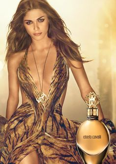 Roberto Cavalli Fragrance** The Cavalli perfume belongs to the ambary floral family. It is an exuberant fragrance whose top notes include pink peppers, at the heart one finds the absolute of orange blossom and the captivating base notes of Tonka beans - Essentially addictive. The line of the bottle recalls the voluptuous curves of a sensual woman.