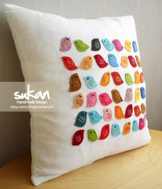 Colorful bird pillow, little details go a long way