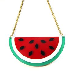 Gorgeous Watermelon Acrylic Statement Necklace. Rock the mouthwatering watermelon trend with this fabulous layered acrylic statement necklace, fashioned from laser-cut acrylic pieced together over a transparent acrylic layer underneath and with the pips attached on top. On a gold tone chain. Awesome.