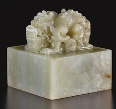 A CELADON JADE DRAGON BUDDHIST SEAL<br>CHINA, QING DYNASTY | lot | Sotheby's