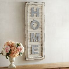 There's no place like it. Our piece is crafted to resemble antiqued wooden shutters with galvanized iron letters that spell out your favorite place to be.