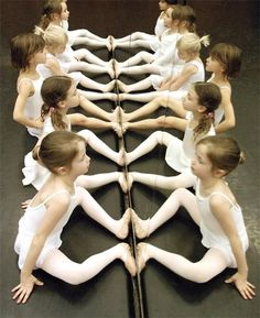 Alternative #2: These precious ballerinas in their pastel outfits are associated (in my mind) with the pastel pink flowers on the cake (pretty and delicate). These delicate ones sit upon a black floor--as rich and dark as the chocolate.