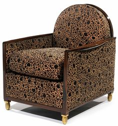 Jacque-Emile Ruhlmann Art Deco tub chair in patterned fabric.