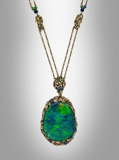 Necklace with a large black opal pendant with a sculpted gold grapevine surround that is enhanced by circular-cut demantoid garnets and sapphires. The pendant's revers … Tiffany Jewelry, Opal Jewelry, Jewellery, Art Nouveau, Art Deco, Museum, Black Opal, Gold Chains, Jewelry Crafts