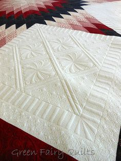 it is fantastic but so obviously computerised quilting - I haven't a hope in getting my quilting anything like as accurate as that no matter how hard I try