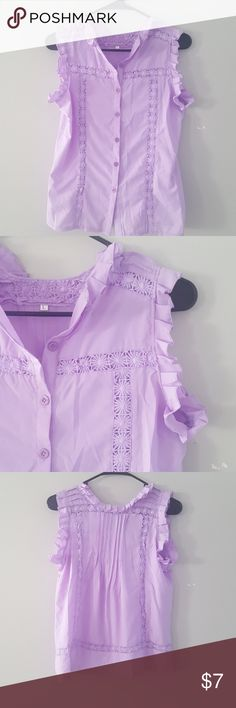 Ruffle Tank with Embroider Detail Cute button-up tank blouse! Beautiful flower stitching on front and back. Ruffles along collar and sleeves. Pleated in back. Size L but fits XS/S. Never worn. Polyester blend, not see through. Tops Tank Tops