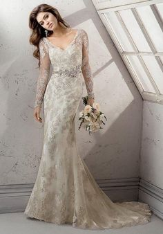 Glimmering metallic embroidered lace on tulle over Orlando satin sheath with dramatic sleeve embellishment, illusion back and V-front neckline via Sottero and Midgley / http://www.himisspuff.com/long-sleeve-wedding-dresses/9/