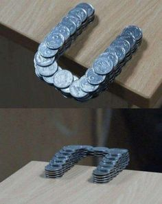 46 Incredible Photos   //  This One is Coins Stacked in Such a Way That They Extend Past the Edge of the Table...