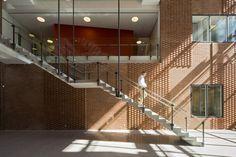Danish Meat Research Institute / C.F. Møller Architects, precast concrete stair, glass guard rails, raised running bond brick pattern