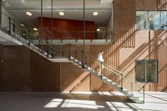 Danish Meat Research Institute / C.F. Møller Architects, precast concrete stair, glass guard rails, raised running bond brick pattern