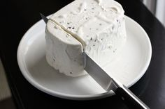 Next time you're serving ice cream at a party throw the scoop away. Just dip the closed ice cream container into a large bowl of hot water from the tap for 15-30 seconds, remove the lid, and invert onto a large platter or wood cutting board, then slice the servings with a hot knife.