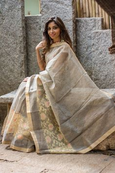 There is never a dull moment with sarees. Even if the color is grey, there can never be a dull moment. This light grey cotton with zari stripes proves that point. With a floral tissue border and muted gold border, she steals everyone's heart slowly but surely. Pair her with a light pink blouse and you're bound to be a winner! #grey #cotton #zari #stripes #floral #border #saree #India #blouse #houseofblouse
