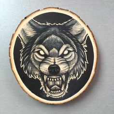 Large wood slice with an original drawing of a wolf door Inkspirednl