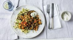 """Aubergines are wonderful roasted, serve with couscous and topped with chickpeas to make this flavourful vegetarian dish.   With a GI of 43 this meal is <a href=""""http://www.bbc.co.uk/food/collections/high-protein_low-gi_recipes"""">high protein, low GI</a> and provides 202 kcal per portion."""