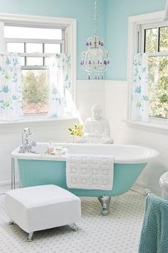 Love the color and the chadielier. Im dreaming of a place to put in one on our next renovation, since C outgrew the frilly stuff and wouldnt let me put it in her bedroom.:(