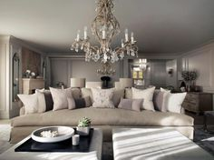 Kelly Hoppen design. Stripes on pillows tie in colour from rest of the room