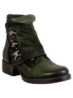 de9b447a8d8b The Miz Mooz Ness bootie features a suede overlay accented with metal  embellishments