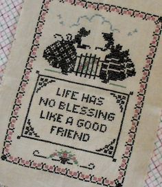 """Vintage """"Friend"""" cross-stitched Vogart sampler with women in bonnets and lots of pink flowers on Etsy, $14.75"""