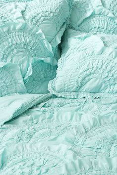 Anthropologie aqua ruffled bedding-not an Anthropologie fan, but I wonder if I could make something similar.