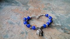 Silver Buddah charm bracelet handmade, original with a vibrant blue glass and antique silver wheels , lobster clasp by SpryHandcrafted on Etsy Handmade Beads, Handmade Bracelets, Beaded Bracelets, Selling On Pinterest, Lobster Clasp, Rose Quartz, Antique Silver, Glass Beads, Vibrant