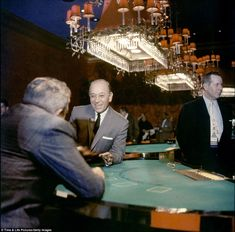 American actor George Raft - (center) laughs as he sits at a gambling table at the Casino de Capri, Havana, Cuba, February (Photo by Francis Miller/Time & Life Pictures/Getty Images) Havana Hotels, Our Man In Havana, Mob Rules, Century Hotel, Sands Hotel, York Hotels, Ballrooms, Handsome Actors, Life Pictures