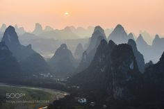 Living among giants - A view from the top of a mountain near Xing Ping China