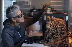 Nita Henry working creating in her factory Electronics, Consumer Electronics