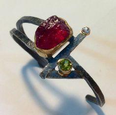 Jib cuff bracelet - 22k and 18k gold, oxidized sterling silver, raw pink tourmaline, peridot, white sapphire