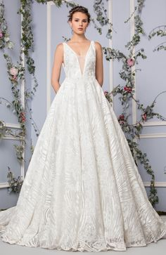 Tony Ward Bridal 2017 l Look 16 l Maeve - Off White A-line Tulle dress with seams of Silk Embroidery and delicate touches of crystals, deep V-neckline.