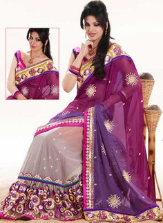 The most beautiful refinements for style and tradition.   This magenta, purple and off white faux georgette and net saree is nicely designed with embroidered patch work is done with resham, zari, sequins, stone and lace work.   Beautiful embroidery work on saree make attractive to impress all.   This saree gives you a modern and different look in fabulous style.   Matching blouse is available.   Slight color variations are possible due to differing screen and photograph resolution.