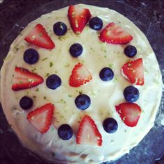 Banana rum cake with fresh berries a lime cream cheese frosting.