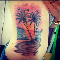 My new palm tree rib tattoo...the best there is out there:) It's amazing!!! Palmtree palm tree tattoo sunset beach colorful tropical beach scene tattoo