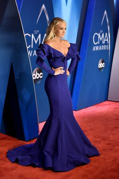Carrie Underwood switches between a dozen dazzling looks at the CMAs