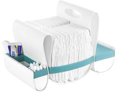 I think this would be a great baby shower gift--it's the most clever and stylish diaper caddy I've seen. (The Loop by Boon)