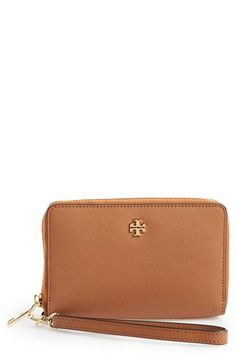 Free shipping and returns on Tory Burch 'York' Smartphone Wristlet at Nordstrom.com. A gilded logo glazes an elegant smartphone wristlet in lavishly textured Saffiano leather.